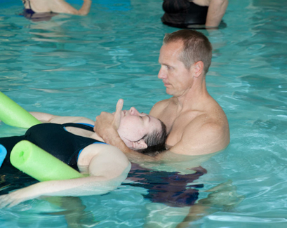 Physical Therapist performing aqua therapy