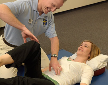 Physical Therapist demonstrating core exercise