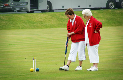 Elderly women playing sports.