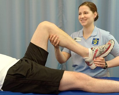 Physical Therapist Mobilizing Knee Joint
